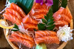 Sushi Salmon on ice in the plate. stock photos