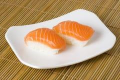 Sushi - Salmon Nigiri. Japanese food - Salmon nigiri on a plate Stock Photos