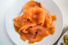 Sushi - Salmon prepared on a dish. Fine salmon fillet prepared for sushi on a white plate Royalty Free Stock Photos