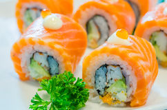 Sushi. Salmon roll sushi with salmon egg on top in white dish Royalty Free Stock Image
