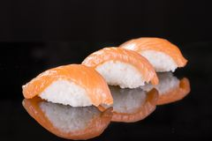 Sushi with salmon three pieces Royalty Free Stock Photography