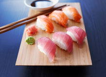 Sushi - Salmon and tuna nigiri. Colorful sushi nigiri with salmon and tuna Stock Photo