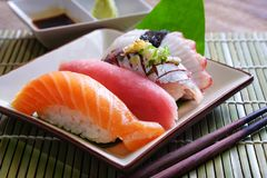 Sushi salmon & tuna sushi shrimp and wasabi royalty free stock photography
