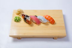 Sushi with salmon on a wooden tray Stock Images