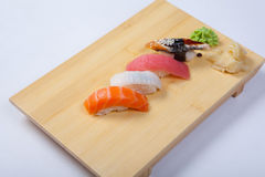 Sushi with salmon on a wooden tray Royalty Free Stock Image