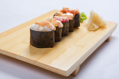 Sushi with salmon on a wooden tray Royalty Free Stock Photos