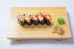 Sushi with salmon on a wooden tray Stock Photo