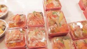 Sushi and sashimi display at Japanese food vendor stock video
