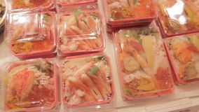 Sushi and sashimi display at Japanese food vendor stock footage