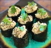 Sushi Sashimi Nigiri Avocado. Rice black sesame seeds toasted sesame seeds scallops cilantro rice sushi sashimi nigiri nori wrapper dinner japanese restaurant Stock Images