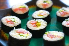 Sushi Sashimi Nigiri Nori Chutoro Toro Salmon Tuna. Check out this beautiful sushi roll made with chutoro though it could easily have been made with toro salmon Stock Photo