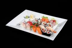 Sushi and sashimi on rectangular white plate Stock Photo