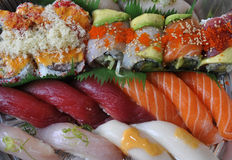 Sushi, sashimi, rolls on tray closeup Royalty Free Stock Photography