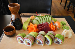 Sushi and sashimi served with vegetables Stock Photos