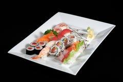 Sushi and sashimi with wasabi on plate Royalty Free Stock Photo