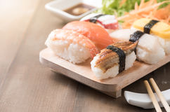 Sushi with sauce and wasabi on old brown wood plate Stock Photos