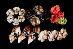 Sushi served on a black background with reflection. Royalty Free Stock Photos