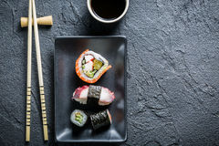 Sushi served on a black ceramic with soy sauce Royalty Free Stock Photography