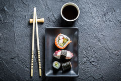 Sushi served on a black ceramic with soy sauce Royalty Free Stock Photos