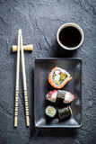 Sushi served on a black ceramic with soy sauce Stock Photos