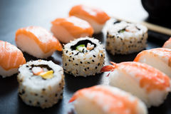 Sushi served on plate. Close up of sushi served on black plate. Delicious japanese cuisine sushi prepared for one person. Fresh sushi served to eat at restaurant stock photography