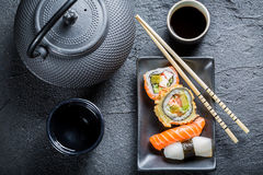 Sushi served with tea. On black rock Stock Image