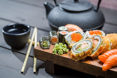 Sushi served with tea Royalty Free Stock Images