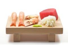 Sushi serving board. Shrimp, crab, tuna, california rice and wasabi Stock Image