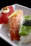 Sushi serviti sulla zolla Immagini Stock