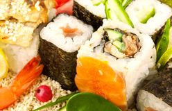 Sushi on sesame seeds with green leaf. Composition from sushi with green leaf on sesame seeds Stock Photo