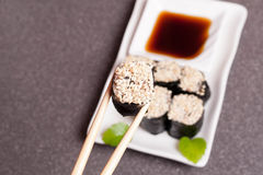 Sushi with sesame on a white plate Stock Photos