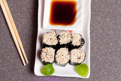 Sushi with sesame on a white plate Royalty Free Stock Photos