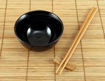 Sushi set. Sushi plate and chopsticks on bamboo mat Royalty Free Stock Photo