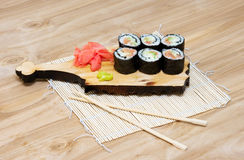 Sushi set. On a wooden stand Stock Photos
