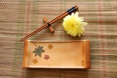 Sushi set on bamboo mat. View from above of sushi plate and chopsticks on mat Stock Images