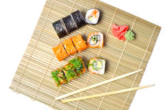 Sushi set on the bamboo mat Royalty Free Stock Photos
