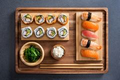 Sushi set on bamboo tray royalty free stock photo
