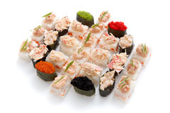 Sushi set for big party. Japanese food on white background Stock Image