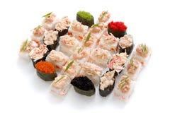 Sushi set for big party. Japanese food on white background Stock Image