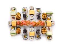 Sushi set for big party. Japanese food on white background Royalty Free Stock Photos