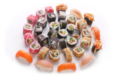 Sushi set for big party. Japanese food on white background Royalty Free Stock Photo