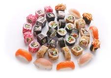 Sushi set for big party. Japanese food on white background Royalty Free Stock Photo