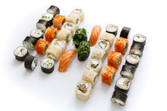Sushi set for big party. Japanese food on white background Stock Photo