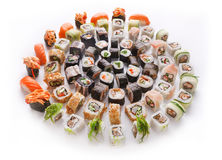 Sushi set for big party. Japanese food on white background Stock Photos