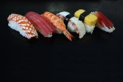 Sushi  set  on black background Stock Images