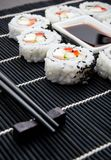 Sushi set on black bamboo mat Stock Photo
