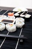Sushi set on black bamboo mat Stock Image