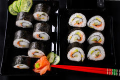 Sushi set on black plates Royalty Free Stock Photography