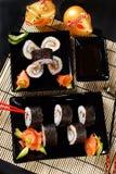 Sushi set on black plates Stock Photography