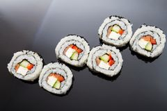 Sushi set on black reflection background Stock Images